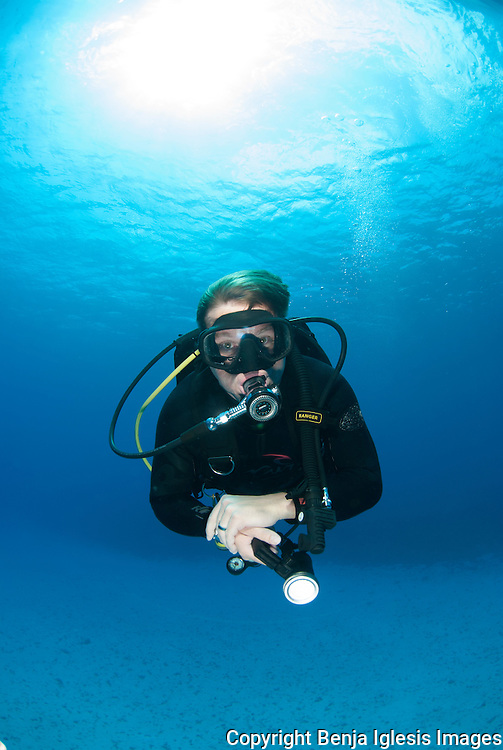 Diver with mares regulator doing safety stop at the sand channel, Molokini Mauio Hawaii.