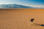 An empty Coleman folding chair is seen sitting in the Alvord Desert in a remote part of Southeast Oregon with Steens Mountain in the background on a hot summer afternoon.