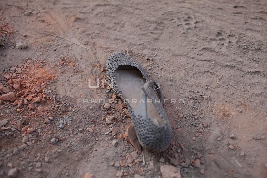 A woman shoe left abandoned near collapsed houses at Bhaktapur, near Kathmandu, Nepal.  May 03, 2015