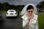 NEW YORK  --  MAY 23, 2004:  A bride smokes one last cigarette before riding in a limo to her wedding ceremony on May 23, 2004.  (PHOTOGRAPH BY MICHAEL NAGLE)