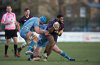 Tangelo Koroi of London Scottish Football Club is tackled by Yorkshire Carnegie players during the Greene King IPA Championship match between London Scottish Football Club and Yorkshire Carnegie at Richmond Athletic Ground, Richmond, United Kingdom on 28 January 2017. Photo by Alan  Stanford/PRiME Media Images.