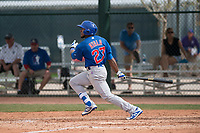 Chicago Cubs center fielder Luis Ayala (27) follows through on his swing during a Minor League Spring Training game against the Oakland Athletics at Sloan Park on March 13, 2018 in Mesa, Arizona. (Zachary Lucy/Four Seam Images)