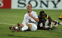 The United States' Brian Ownby (15) reacts after having a drive to goal  stopped by Cameroon's  Brian Ownby (1) during the FIFA Under 20 World Cup Group C Match between the United States and Cameroon at the Mubarak Stadium on September 29, 2009 in Suez, Egypt.