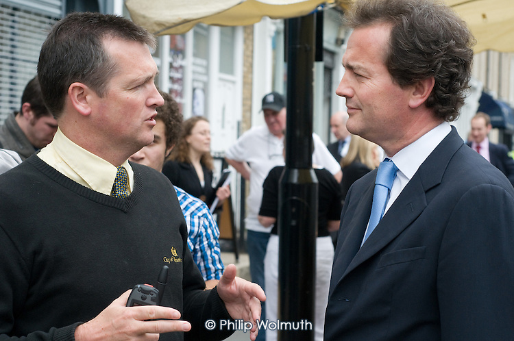 Conservative MP Nick Hurd, newly appointed Minister for Civil Society, speaks to a Neighbourhood Warden during a visit to projects in Church Street, London,  supported by the Paddington Development Trust.