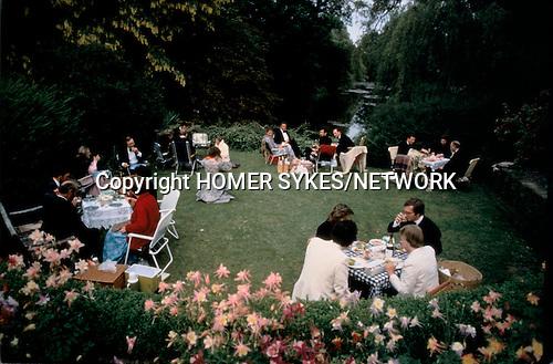Glyndebourne Festival Opera al fresco picnic gardens garden during interval East Sussex UK 1980s