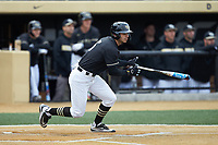 Patrick Frick (5) of the Wake Forest Demon Deacons follows through on his swing against the Illinois Fighting Illini at David F. Couch Ballpark on February 16, 2019 in  Winston-Salem, North Carolina.  The Fighting Illini defeated the Demon Deacons 5-2.  (Brian Westerholt/Four Seam Images)