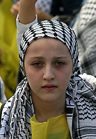 """Palestinian girl Fatah supporters gather at a rally marking the third anniversary of the death of the late Palestinian leader Yasser Arafat in Gaza City, Monday, Nov. 12, 2007. Hamas security forces opened fire at a mass rally commemorating the death of the late Palestinian leader, violently dispersing the largest public display of support for the rival Fatah movement since Hamas seized control of the Gaza Strip in June. Five people were killed and at least 31 were wounded, medical officials and Fatah said.""""photo by Fad Adwan"""""""
