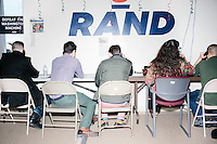 Campaign workers and volunteers call potential voters from the phone bank at the campaign headquarters of Kentucky senator and Republican presidential candidate Rand Paul during a celebration at his campaign headquarters in Manchester, New Hampshire.