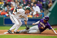 LSU Tigers first baseman Danny Zardon (27) slides as Baylor Bears third baseman Jonathan Ducoff (37) tags him during the NCAA baseball game on March 7, 2015 in the Houston College Classic at Minute Maid Park in Houston, Texas. LSU defeated Baylor 2-0. (Andrew Woolley/Four Seam Images)
