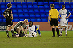 Tranmere Rovers 2  Port Vale 0, 20/03/2019. Prenton Park, League One. Club physiotherapist Les Parry on the pitch treating injured team captain Ian Goddison at Prenton Park, home of Tranmere Rovers during a match against Port Vale in a English League One fixture. Les Parry has been the club physiotherapist since 1993 and recently completed 800 games with the club. At the time he was also working on completing his PhD at Liverpool John Moores University. Photo by Colin McPherson.