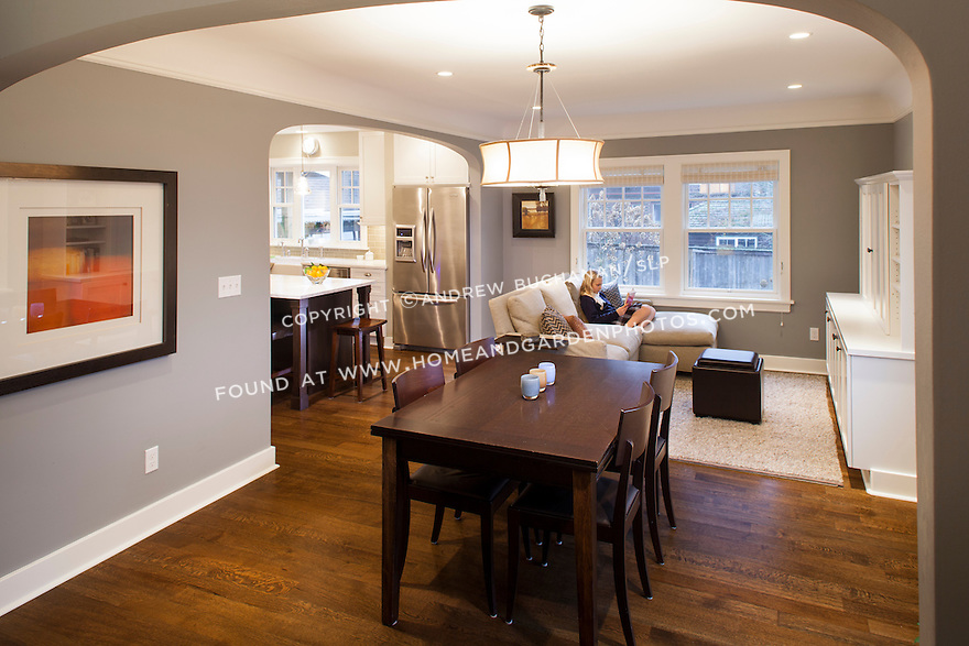 A girl enjoys some quiet reading time in the family room area of her newly remodeled home.