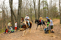 Troop 10 Boy Scouts take a break to rest during a spring backpacking in the South Mountains State Park in Connelly Springs, North Carolina.