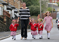 """Pictured: Ffion, mum Karen, Paige, Maddison, and older sister Faye  <br /> Re: A set of identical triplets have been colour-coded to help teachers tell them apart on their first day in nursery school.<br /> Three-year-olds Ffion, Maddison and Paige Gilbert, are so alike even their parents struggle to know which is which.<br /> Karen and Ian Gilbert used different coloured nail-varnish on their fingers and toes to identify them when they were babies.<br /> Now the couple are using the same colours for their hair bands and bobbles at the nursery where they have just enrolled.<br /> And the colours even correspond with the names of the identical trio. <br /> Ffion has fuschia, Maddison has mint and Paige has purple.<br /> Karen, 35, of Pontypool, South Wales, said: """"We have colour-coded them since they were tiny babies - it helped us keep track of which ones had been fed.<br /> """"But nail varnish isn't allowed in school so we had come up with come other way."""