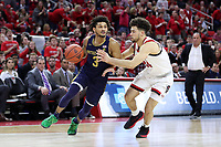 RALEIGH, NC - JANUARY 9: Prentiss Hubb #3 of the University of Notre Dame drives against Devon Daniels #24 of North Carolina State University during a game between Notre Dame and NC State at PNC Arena on January 9, 2020 in Raleigh, North Carolina.