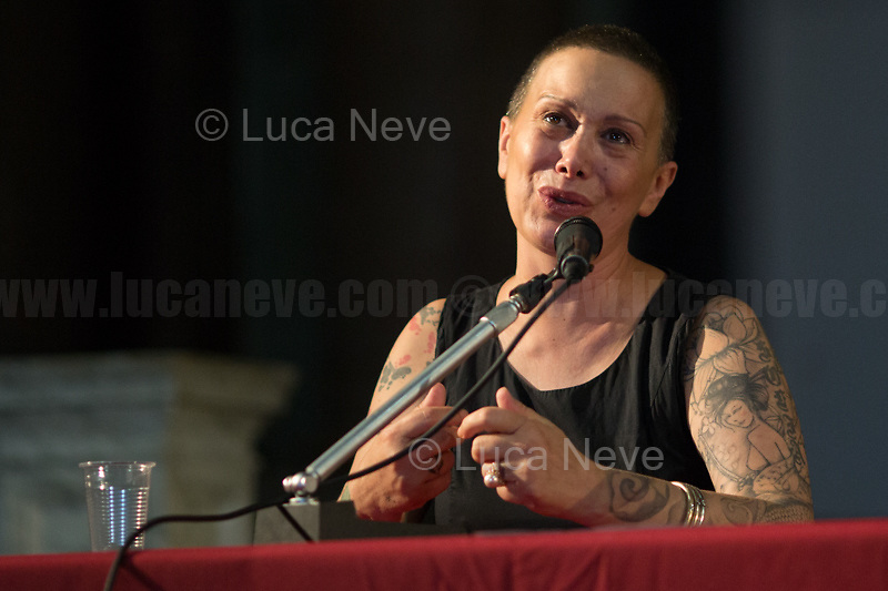 """The Aunt of Emanuel Scalabrin.<br /> <br /> Genoa (Genova, Liguria), Italy. 19th, 20th, 21st July 2021. Twenty years after the dramatic and terrifying events related to the 2001 Genoa's G8 meeting, according to Amnesty International: """"the most serious suspension of democratic rights in a Western country since the Second World War"""" (1.) and as stated on the 2001 """"Report on the situation of fundamental rights in the EU"""" the European Parliament's """"deplores the suspensions of fundamental rights that took place during public demonstrations, and in particular at the G8 meeting in Genoa, such as freedom of expression, freedom of movement, the right to physical integrity"""" (2.). As a reminder, the City of Genoa is State Gold Medal (Medaglia D'Oro) for its Antifascist Resistance in World War II.<br /> <br /> In these three days, throughout a series of events, Genoa and its People, survivors and witnesses, experts and activists, remembered what happened 20 years ago, discussed the present situation of a world dominated by """"casino capitalism"""", predatory neo-liberalism, wars, rightless globalization, environmental and ecosystem degradation, doped consumerism, sources' depredation, fake news, internet deregulated jungle, the reality of climate change and pandemics, and what a different future and society could be.<br /> <br /> FOR MORE INFO READ THE ARTICLE AT THE BEGINNING OF THIS STORY.<br /> <br /> Footnotes, Links:<br /> 1. http://bit.do/fRvdg<br /> 2. http://bit.do/fRvdi<br /> 3. http://bit.do/fRvdj<br /> 4. http://bit.do/fRvdn<br /> 5. http://bit.do/fRvdo<br /> 6. 12.10.18 - Sulla Mia Pelle: Stefano Cucchi's Film Screening At CSOA La Strada http://bit.do/fRvdr<br /> 7. http://bit.do/fRvdt & http://bit.do/fRvdu<br /> 8. http://bit.do/fRvdv & http://bit.do/fRvdw & http://bit.do/fRvdx<br /> 9. http://bit.do/fRvdz<br /> 10. http://bit.do/fRvdA<br /> 11. http://bit.do/fRvdB<br /> http://www.veritagiustizia.it/docs/G8_2021_prog_ITA.pdf http://www.veritagiustizia.it/doc_eng/<br />"""
