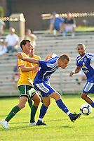 Simone Bracalello (blue, minn), Zach Bauer...AC St Louis and NSC Minnesota Stars played to a 2-2 tie at Anheuser-Busch Soccer Park, Fenton, Missouri.