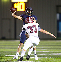Luke Buchanan (8) of Springdale Har-ber gets pressured by  Gunner Cornelison (33) of Springdale on Friday, Oct. 8, 2021, during the first half of play at Wildcat Stadium in Springdale. Visit nwaonline.com/211009Daily/ for today's photo gallery.<br /> (Special to the NWA Democrat-Gazette/David Beach)