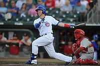 Iowa Cubs Matt Murton (25) swings during the Pacific Coast League game against the Memphis Redbirds at Principal Park on June 6, 2016 in Des Moines, Iowa.  Memphis won 6-2.  (Dennis Hubbard/Four Seam Images)