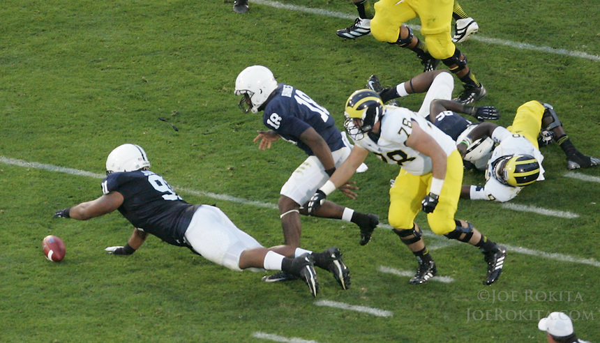State College, PA - 10/12/2013:  DL DaQuan Jones dives to recover a fumble near the end of the first half.  Penn State defeated Michigan by a score of 43-40 in 4 overtimes on Saturday, October 12, 2013, at Beaver Stadium.<br /> <br /> Photos by Joe Rokita / JoeRokita.com