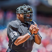 31 May 2014: MLB Umpire Laz Diaz rubs down a baseball during a game between the Washington Nationals and the Texas Rangers at Nationals Park in Washington, DC. The Nationals defeated the Rangers 10-2, notching a second win of their 3-game inter-league series. Mandatory Credit: Ed Wolfstein Photo *** RAW (NEF) Image File Available ***