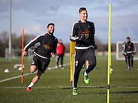 Pictured L-R: Jordi Amat chases Federico Fernandez Thursday 25 February<br />