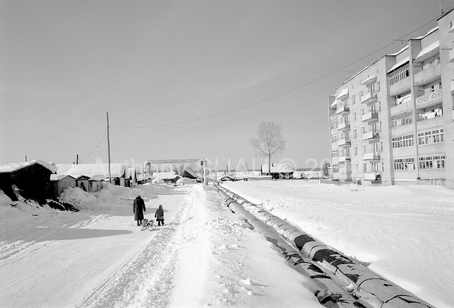 Rudichnii, Russia  .March 1999.A grandmother and her grandson walk home together through the village heavy snow..