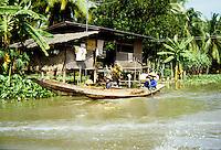 Longboat paddling down the river in Bangkok, Thailand