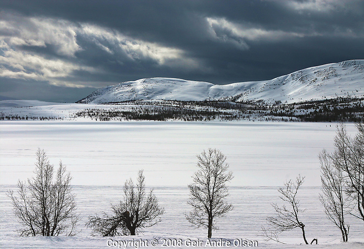 Threatening sky over Flaksjoen, a small lake at Venabygdsfjell, Norway in the winter