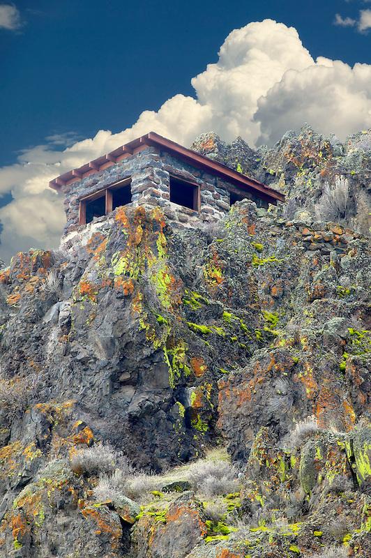 Old rock shack.and beginning thunderstorm clouds. Tule Lake National Wildlife Refuge, California