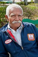 Cuba, Cienfuegos.  Old Man, wearing Used Jacket of Oldsmobile Employee.