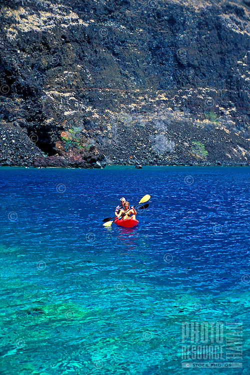 A couple kayaks on the peaceful and pristine blue water of Kealakekua Bay. As of 2013 a moratorium halting all kaying in the bay has been issued by the Dept. of Land and Natural Resources. This could be revoked at anytime.
