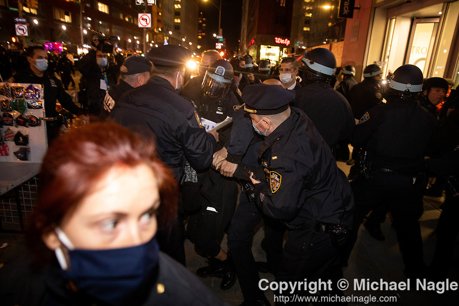 NYPD police officers arrest demonstrators during a protest demanding every vote cast be counted in the 2020 presidential election between U.S. President Donald Trump and former Vice President Joe Biden on November 4, 2020 in New York City.  Photograph by Michael Nagle