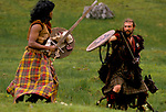 'CLAN, THE' SCOTLAND, A GROUP WHO SPEND THEIR WEEKENDS AT A CAMP IN GLEN CROE, RECREATING THE LIFE OF A SCOTTISH CLAN BEFORE THE DEFEAT OF BONNIE PRINCE CHARLIE BY THE ENGLISH AT THE BATTLE OF CULLODEN IN 1746. TWO MEMBERS PRACTICE FIGHTING WITH BROADSWORDS & WOODEN SHIELDS, 1989