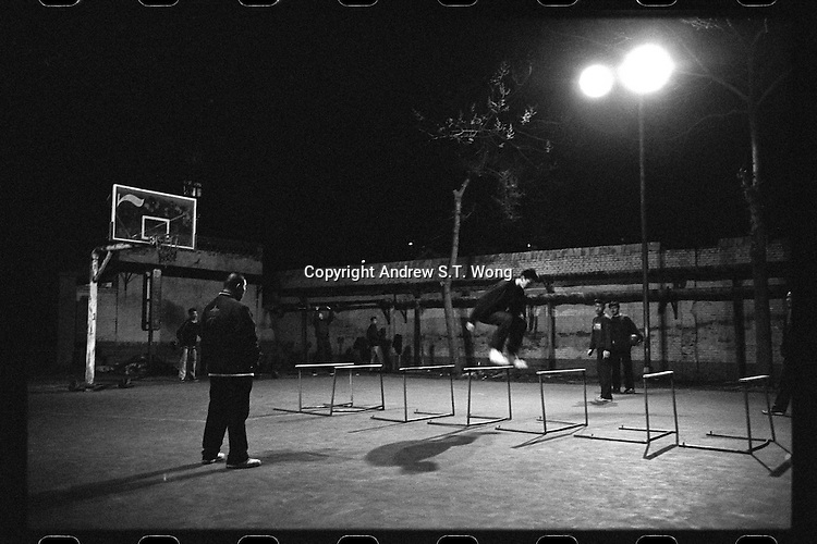 Basketball players of Jinhua Middle School in Jinzhong, Shanxi province, take part in a training session in sub-zero temperatures in February 2012.  The old and humble sports facilities at Jinhua Middle School, founded in 1958, do not diminish the passion of their basketball players. They practise seven days a week on their outdoor courts even in sub-zero temperatures.