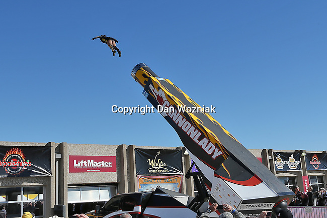 The Cannon Lady performs before the NASCAR Sprint Cup Series AAA 500 race at Texas Motor Speedway in Fort Worth,Texas.