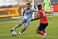 KANSAS CITY, KS - SEPTEMBER 02: Roberto Puncec #4 of Sporting Kansas City takes on Santiago Mosquera #11 of FC Dallas during a game between FC Dallas and Sporting Kansas City at Children's Mercy Park on September 02, 2020 in Kansas City, Kansas.