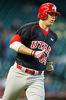 C.J. Cron #24 of the Utah Utes rounds first base against the Baylor Bears at Minute Maid Park on March 5, 2011 in Houston, Texas.  Photo by Brian Westerholt / Four Seam Images