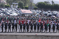 Mexican fans yell and swear at United States fans as they leave Azteca Stadium under a police escort. Mexican police officers in riot gear separated the team's fan supporters to prevent any violence. The United States Men's National Team played Mexico in a CONCACAF World Cup Qualifier match at Azteca Stadium in, Mexico City, Mexico on Wednesday, August 12, 2009.