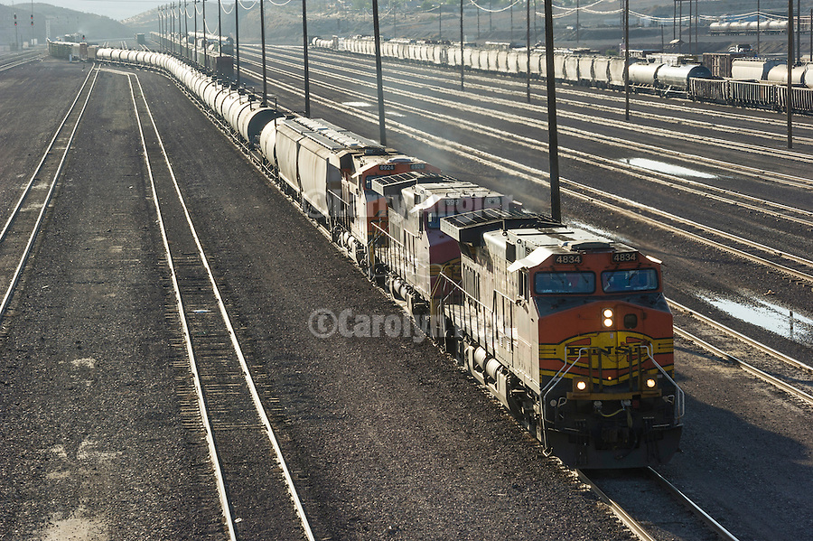 BNSF string of tank cars approached the rail yard from the east at Barstow, Calif.