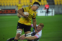 Hurricanes' Reed Prinsep is tackled during the Super Rugby Tran-Tasman match between the Hurricanes and Rebels at Sky Stadium in Wellington, New Zealand on Friday, 21 May 2020. Photo: Dave Lintott / lintottphoto.co.nz