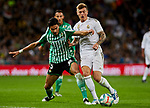 Toni Kroos of Real Madrid and Marc Bartra of Real Betis Balompie during La Liga match between Real Madrid and Real Betis Balompie at Santiago Bernabeu Stadium in Madrid, Spain. November 02, 2019. (ALTERPHOTOS/A. Perez Meca)