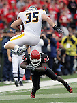 Rutgers # 21 (lower)- Devin McCourty misses the tackle of West Virginia's # 35- (top)- Owen Schimitt as he leaps over McCourty for 1st down yardage, as Rutgers is beaten by West Virginia 31-3 on Sat.Oct. 27,2007.<br /> (MARK R. SULLIVAN)