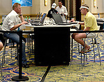 Keith Anderson dressed in 80's tennis outfit to battle Boris Becker in heads uo online poker.