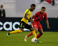 NASHVILLE, TN - JULY 3: Junior Flemmings #12 attacks with Reggie Cannon #14 defending during a game between Jamaica and USMNT at Nissan Stadium on July 3, 2019 in Nashville, Tennessee.