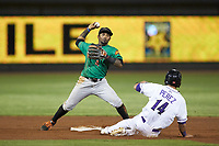 Yonny Hernandez (4) of the Down East Wood Ducks makes a throw to first base as Carlos Perez (14) of the Winston-Salem Dash slides into second base at BB&T Ballpark on May 10, 2019 in Winston-Salem, North Carolina. The Wood Ducks defeated the Dash 9-2. (Brian Westerholt/Four Seam Images)