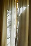 Pattern from light through curtain windows.