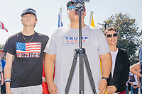 Boston-area conservative youtuber Gabriel on Politics (center) is seen as alt-right organization Super Happy Fun America demonstrates against facemasks, vaccines, and pandemic closures, and in support of the reelection of President Donald J. Trump near the residence of Massachusetts governor Charlie Baker in Swampscott, Massachusetts, on Sat., Sept. 26, 2020. Super Happy Fun America is most well known for organizing the Straight Pride Parade in Boston on August 31, 2019.