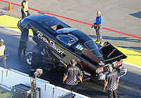 Aug 15, 2014; Brainerd, MN, USA; Crew members with NHRA funny car driver Brian Stewart during qualifying for the Lucas Oil Nationals at Brainerd International Raceway. Mandatory Credit: Mark J. Rebilas-