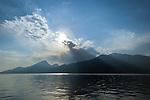 Italy, Veneto, Lake Garda, Brenzone sul Garda: mystic atmosphere at lake Garda, single fishing boat | Italien, Venetien, Gardasee, Brenzone sul Garda: mystische Lichtstimmung ueber dem Gardasee, ein einzelnes Fischerboot auf dem See