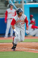 Jhoan Urena (13) of the Brooklyn Cyclones hustles down the first base line against the Hudson Valley Renegades at Dutchess Stadium on June 18, 2014 in Wappingers Falls, New York.  The Cyclones defeated the Renegades 4-3 in 10 innings.  (Brian Westerholt/Four Seam Images)